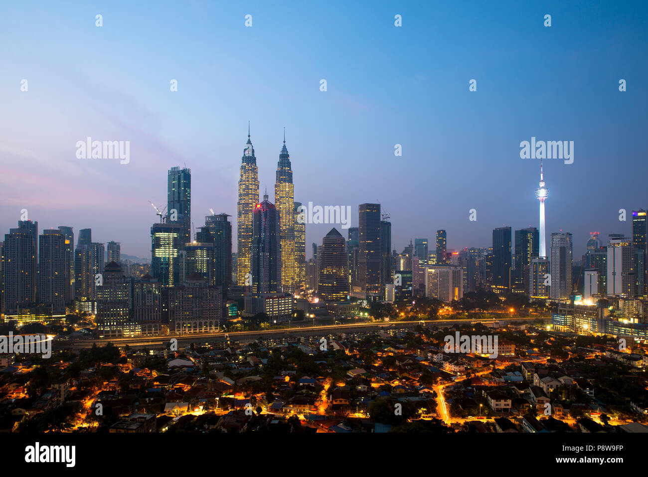 Kuala lumpur cityscape. Panoramic view of Kuala Lumpur city skyline during sunrise viewing skyscrapers building and Petronas twin tower in Malaysia. Stock Photo