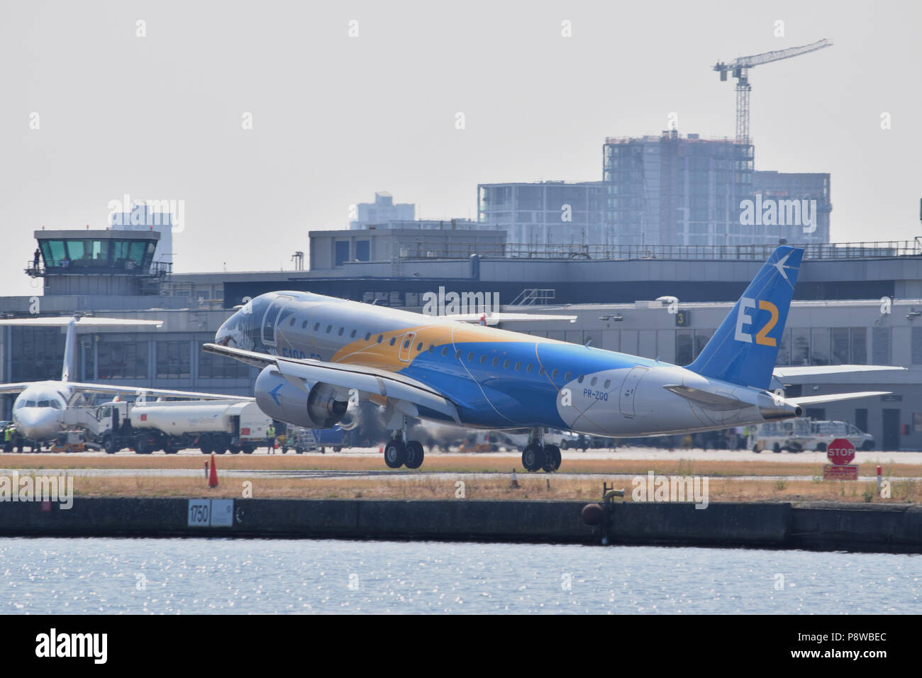 The all new Embraer E190 E2 medium range jet airliner makes its maiden arrival to London City Airport located in London's Royal Docks - Stock Image
