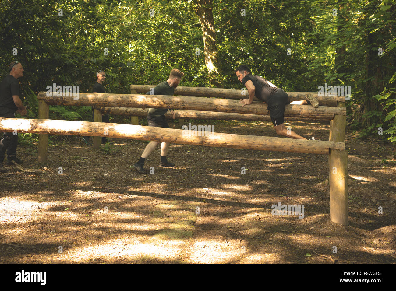 Group of mens training on fitness trail - Stock Image