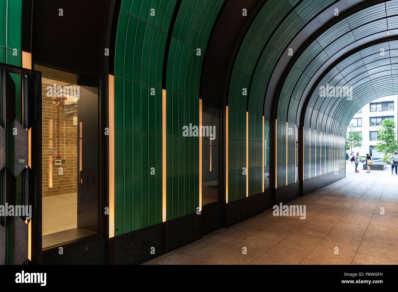 Arched passageway, London, England, UK. - Stock Image