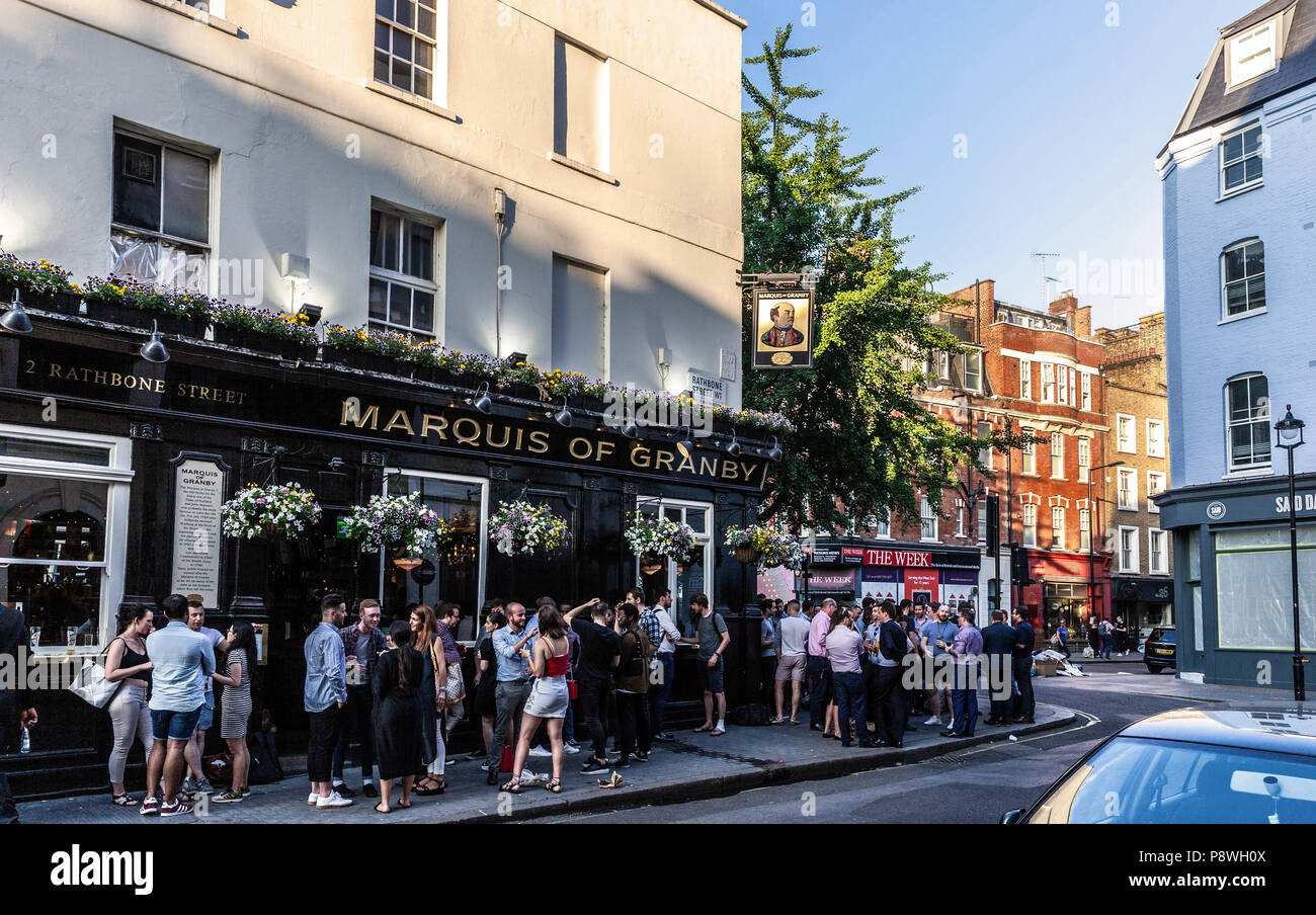 Summer crowd of patrons standing outside Marquis of Granby Pub, Rathbone Street, Fitzrovia, London, W1T, England, UK. - Stock Image