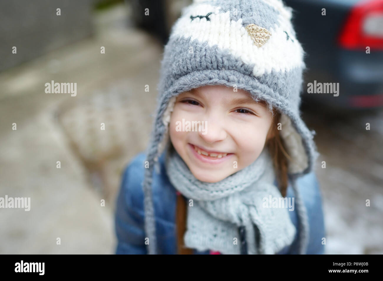 36b285286 Adorable little girl wearing winter hat making funny faces on ...