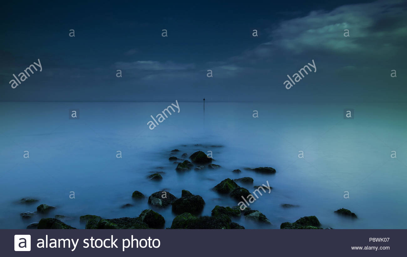 Surreal photograph of groyne marker, Colwyn Bay, Wales - Stock Image