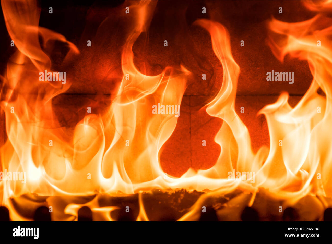 Relaxing fire in a closed fireplace Stock Photo: 212010014