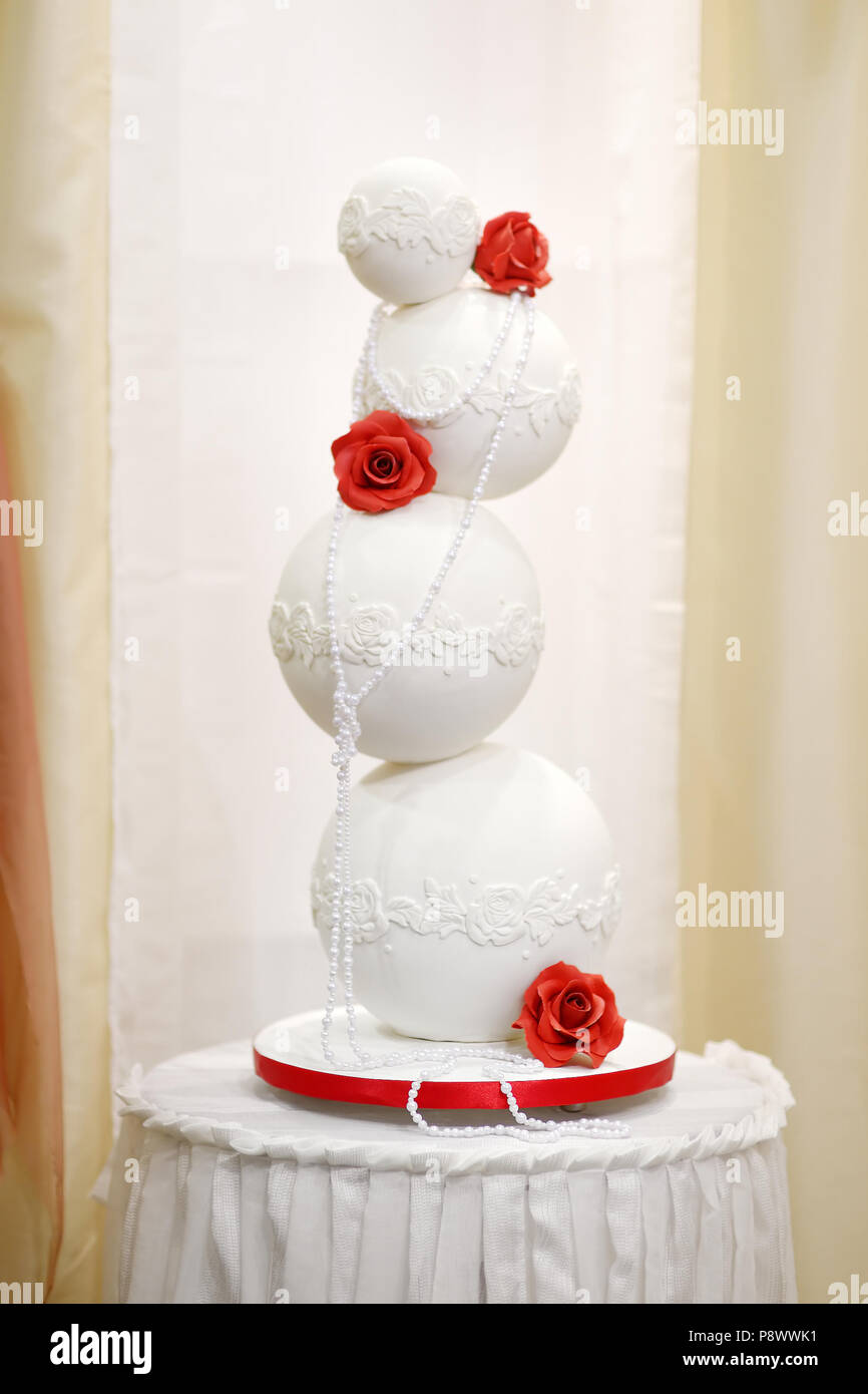 Big wedding cake decorated with red flowers Stock Photo: 212010597 ...
