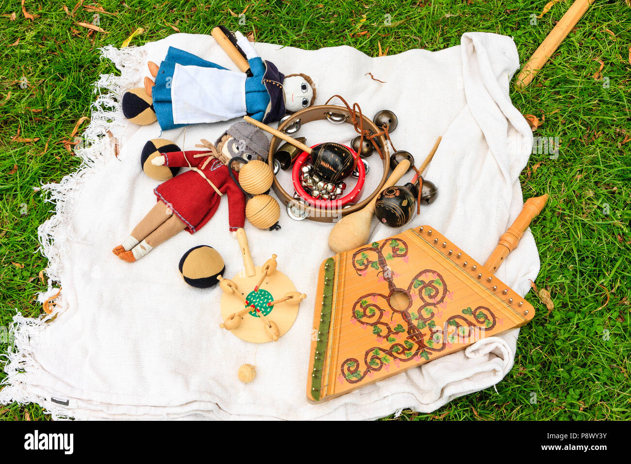 Re-enactment, living history. Medieval Middles ages collection of children's toys and musical instrument, a plucked sultry on display. - Stock Image