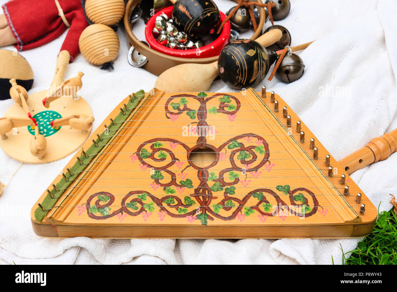 Reenactment event. Reconstructed medieval musical instrument, stringed plucked sultry, wooden box base with strings drawn across. - Stock Image