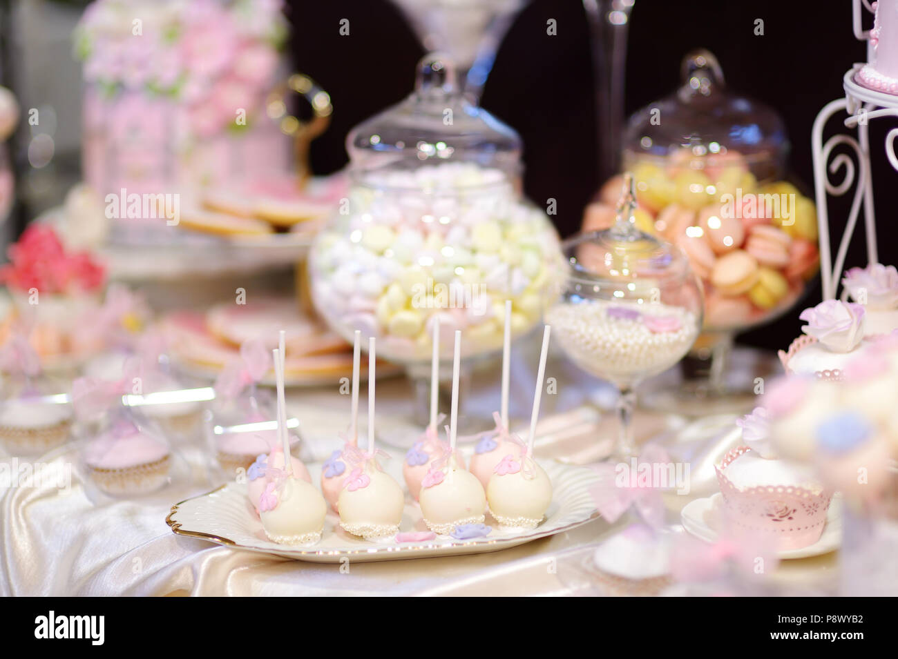 Beautiful desserts, sweets and candy table at wedding reception ot ...