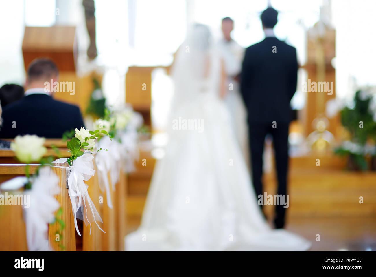 Beautiful flower wedding decoration in a church during catholic ...