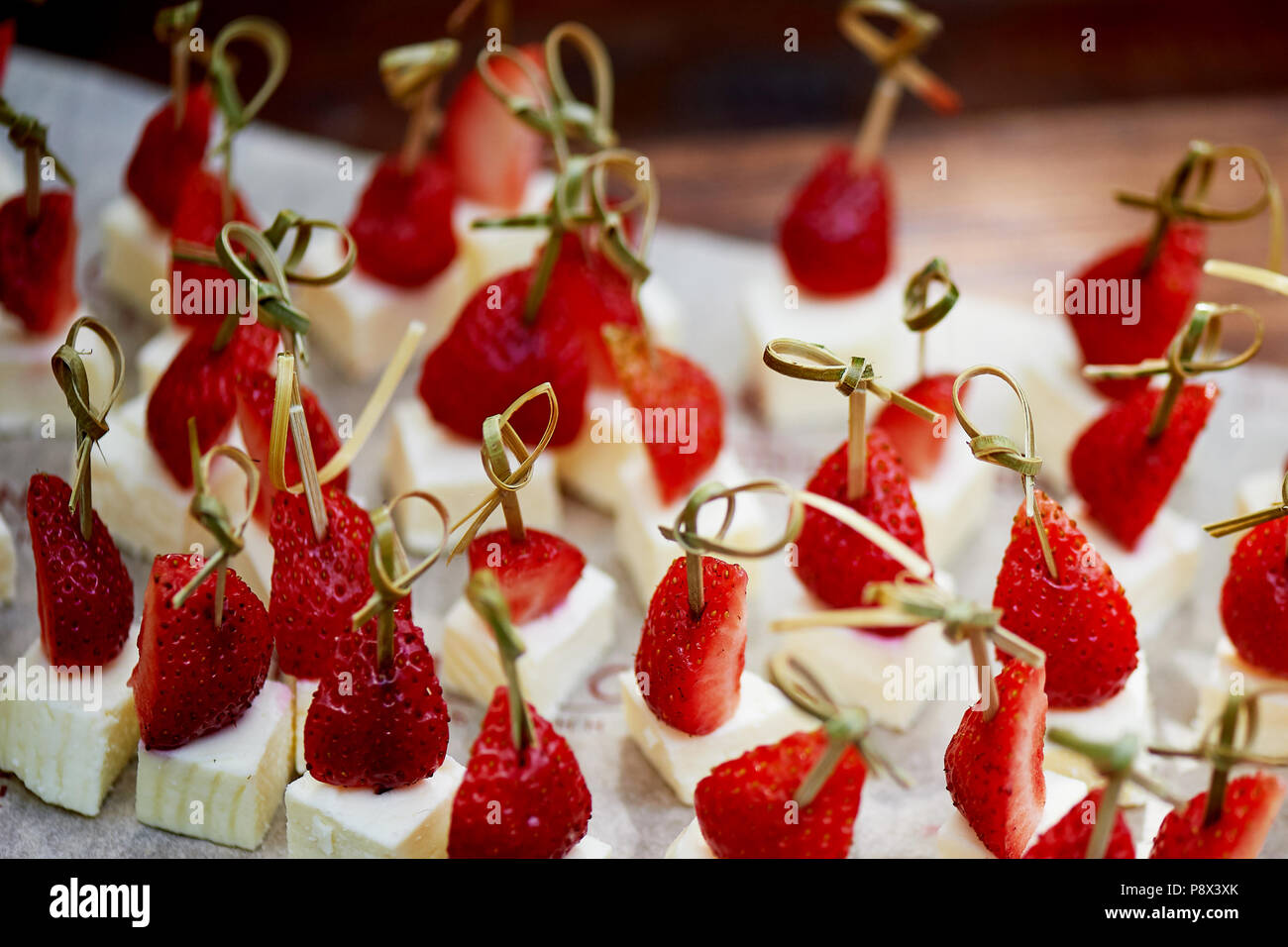 Catering for the wedding Banquet. Strawberry and cheese canap  - Stock Image