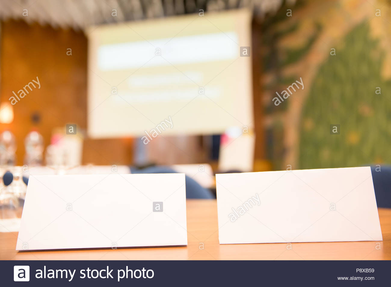 white name tag on office desk at public meeting stock photo
