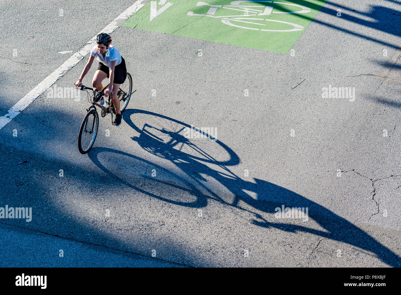 Cyclist using dedicated bike lane, Vancouver, British Columbia, Canada. - Stock Image