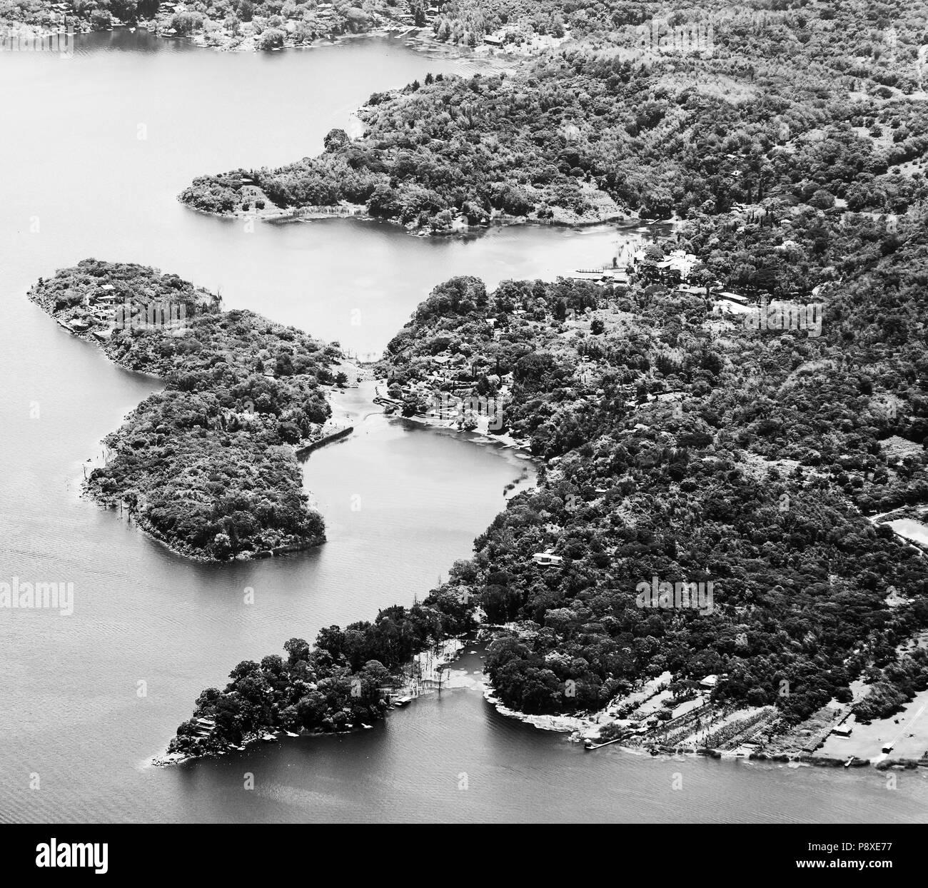 Lake Atitlan shoreline town Santiago, Guatemala, Central America in black and white - Stock Image