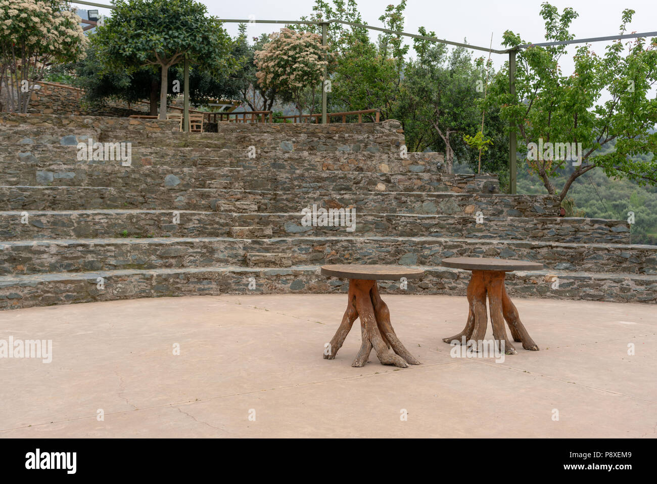 Theater and vine root tables at Botanical garden of Crete, Chania - Stock Image