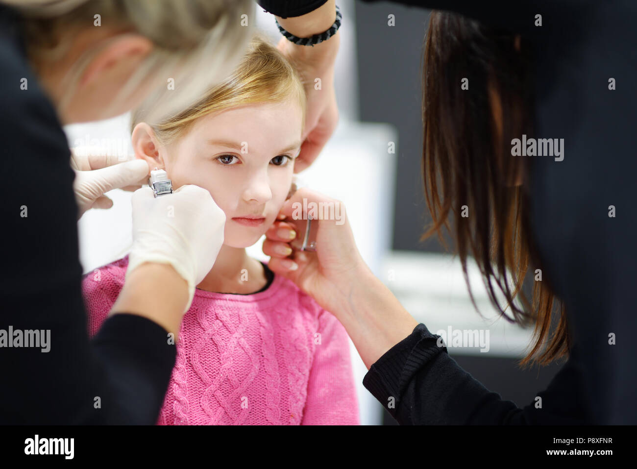 Adorable Little Girl Having Ear Piercing Process With Special
