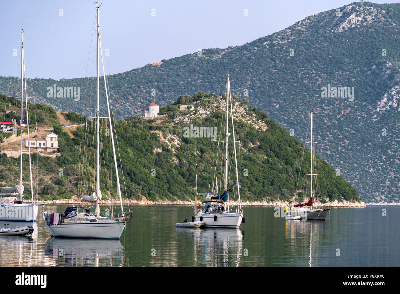 Yachts moored in Vathy harbour. On the island of Ithaca, Ionian Sea, Greece - Stock Image