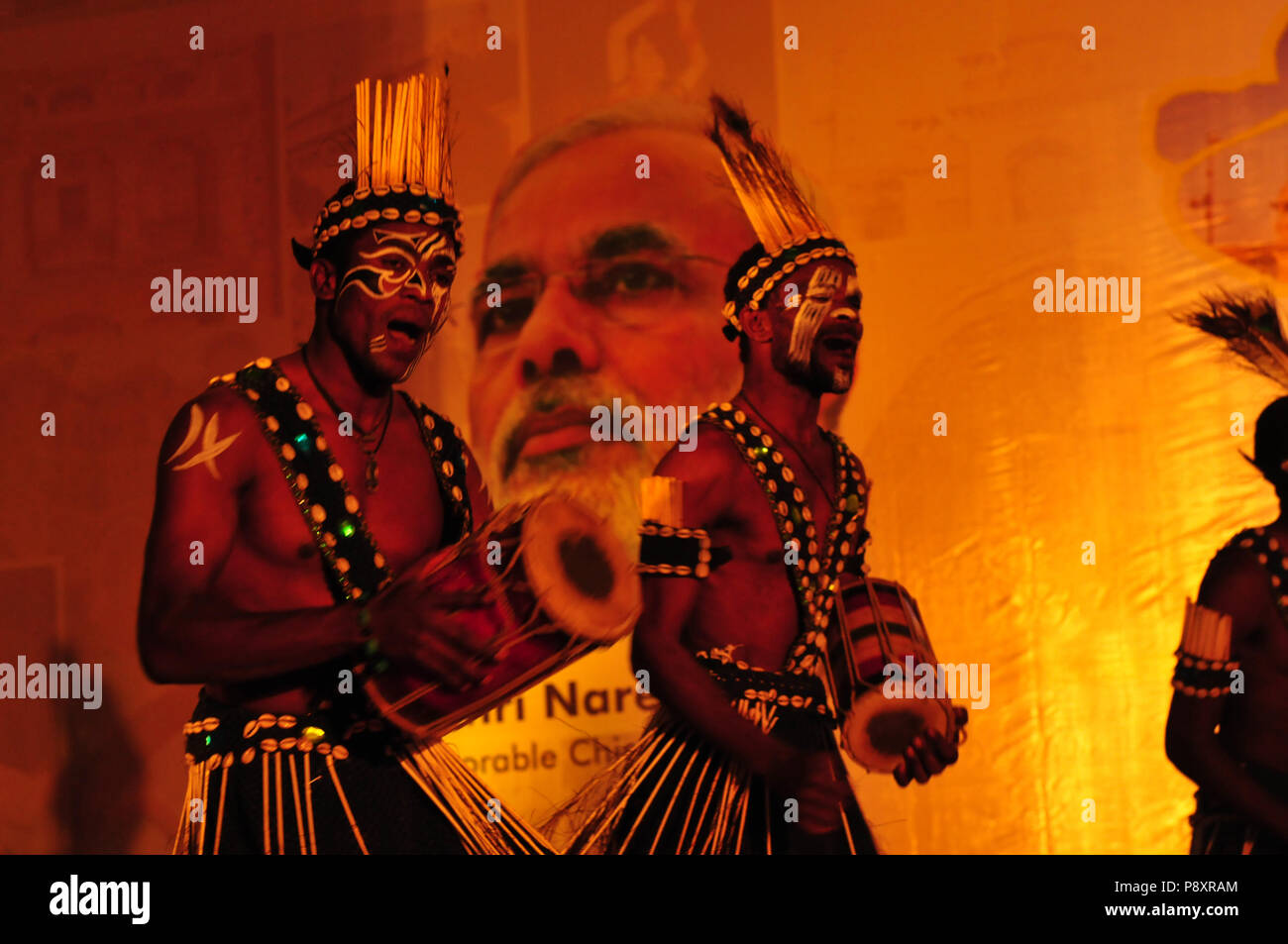 Gujarati tribal people show at the travel mart in Ahmedabad with Premier Minister Narenda Modi - Stock Image