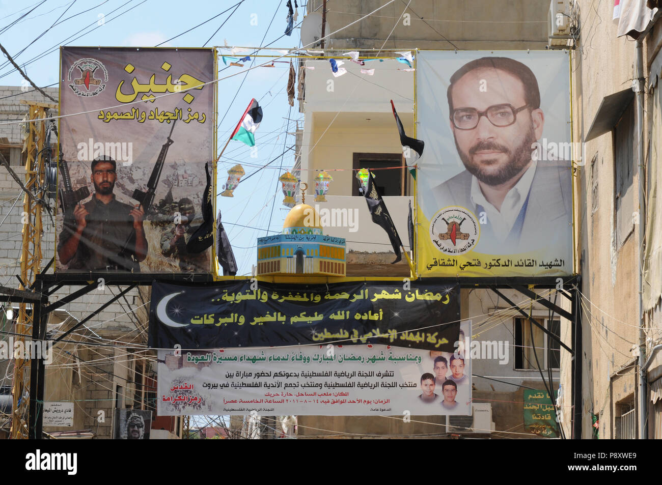 Lebanon:  Political and religios paroles on posters in the palestinian refugie camp Schatila in Beirut. - Stock Image