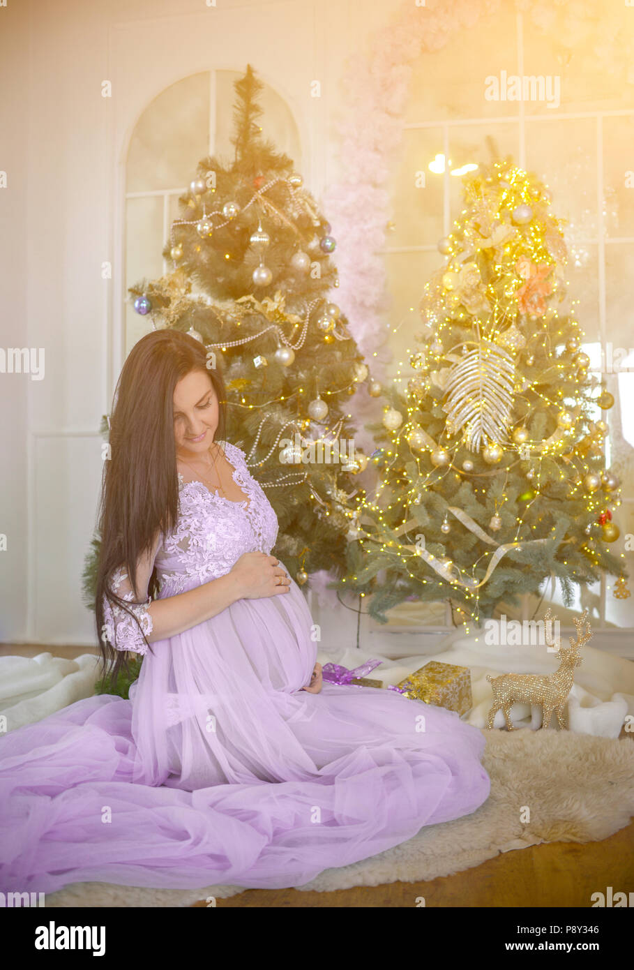 Odessa, Ukraine. 05 January 2017. Young pregnant woman in pink dress ...