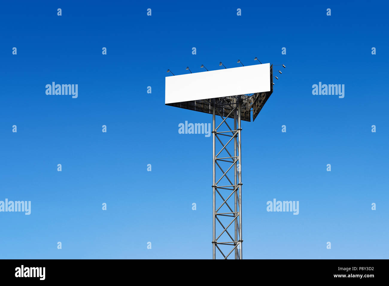 Blank Billboard against a blue sky - Stock Image