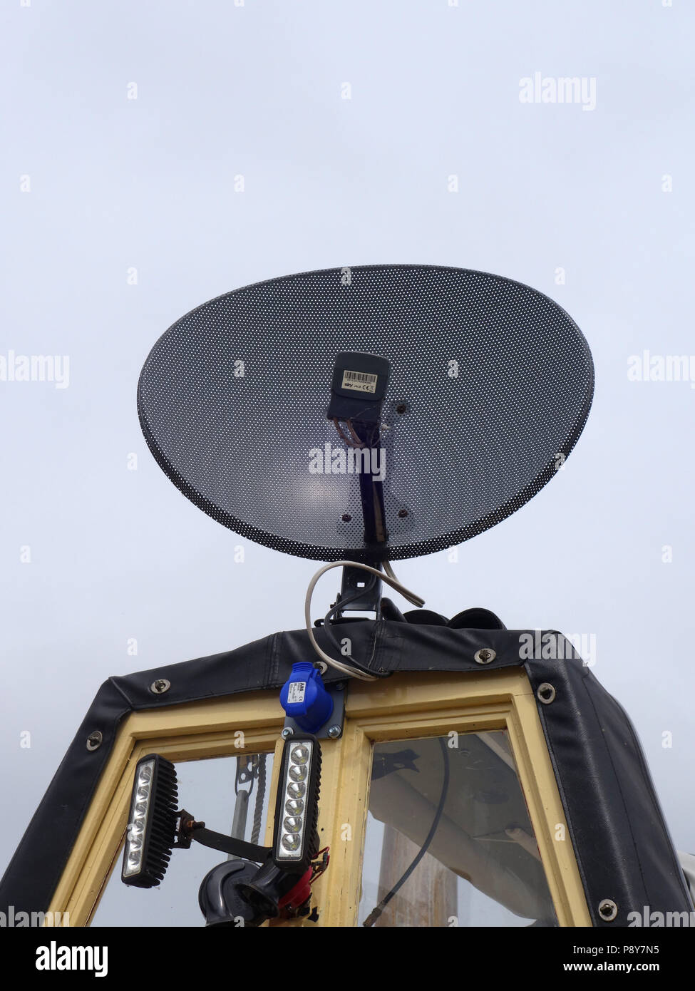 Narrowboat spare room cratch with Satellite TV dish mounted on the roof Stock Photo