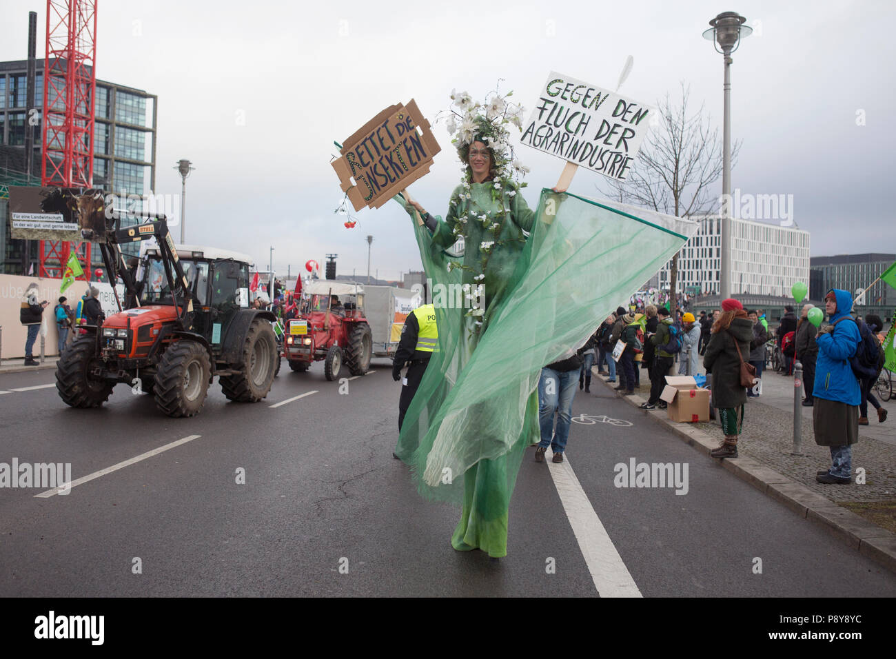 Berlin, Germany, woman on stilts demonstrates at the demo - We are sick of it! - Stock Image