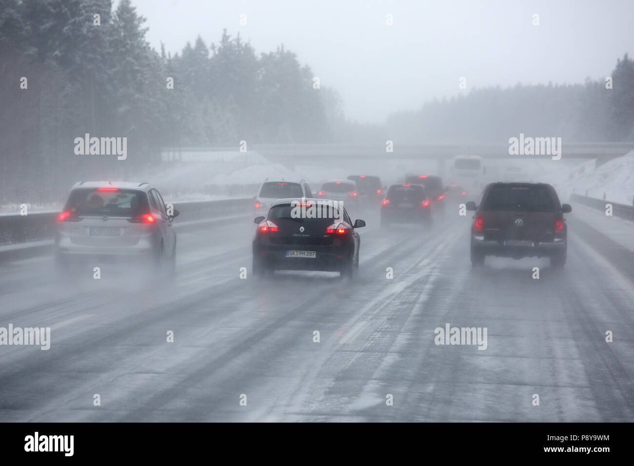 Droyssig, Germany, poor visibility on the A9 motorway in snowfall Stock Photo