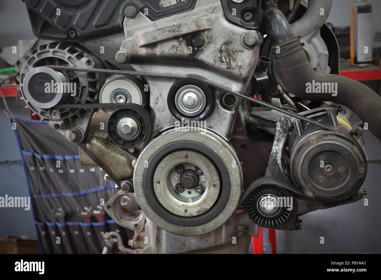 Pk belt, pulleys and alternator at modern car engine after servicing - Stock Image