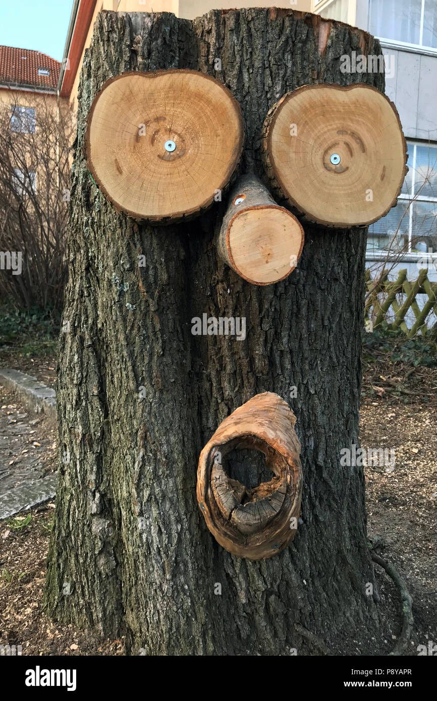 Berlin, Germany, tree stump with face, a so-called tree puck - Stock Image