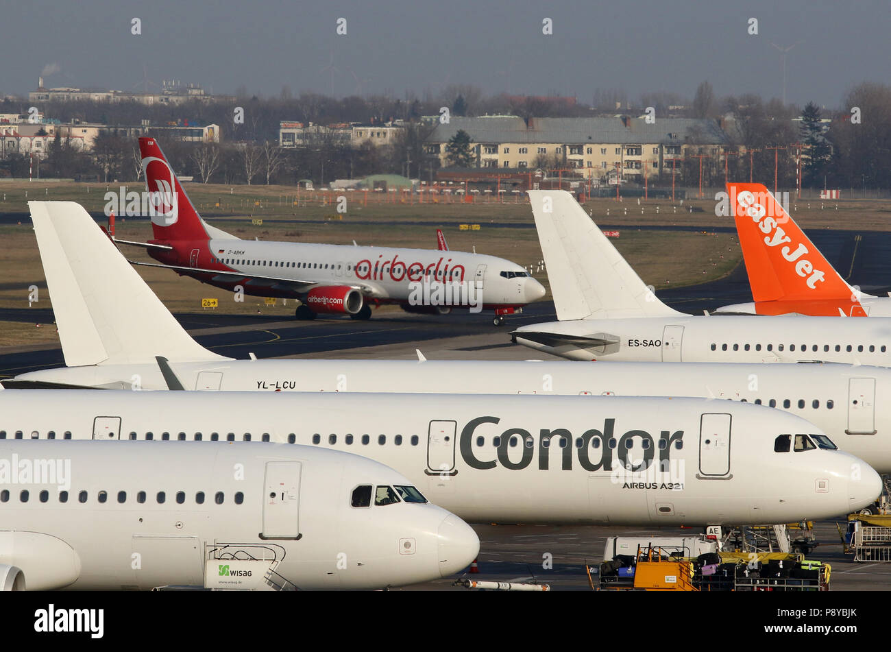 Berlin, Germany, aircraft of the airlines Air Berlin, easyJet and Condor on the apron of the airport Berlin-Tegel - Stock Image