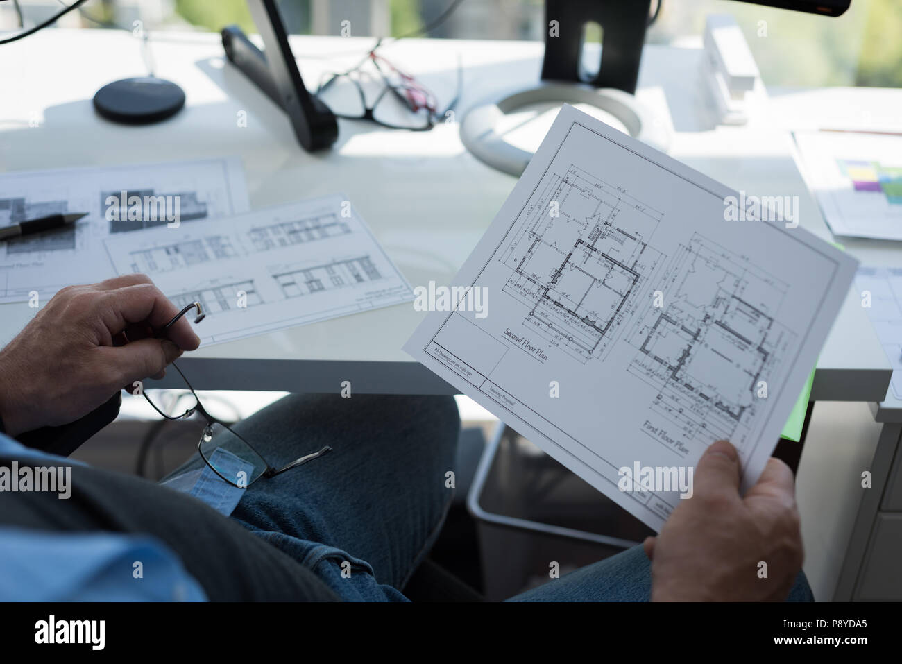 Man looking at architectural chart - Stock Image
