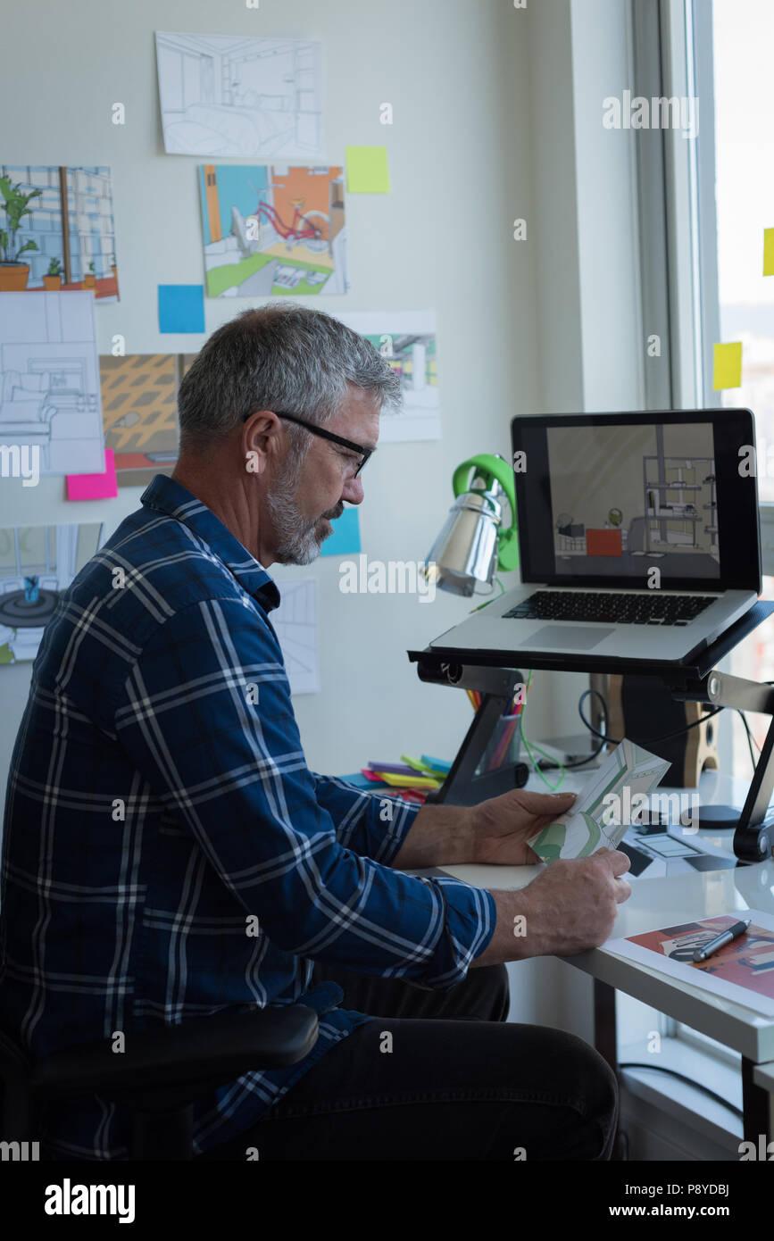 Man looking at architectural chart - Stock Image