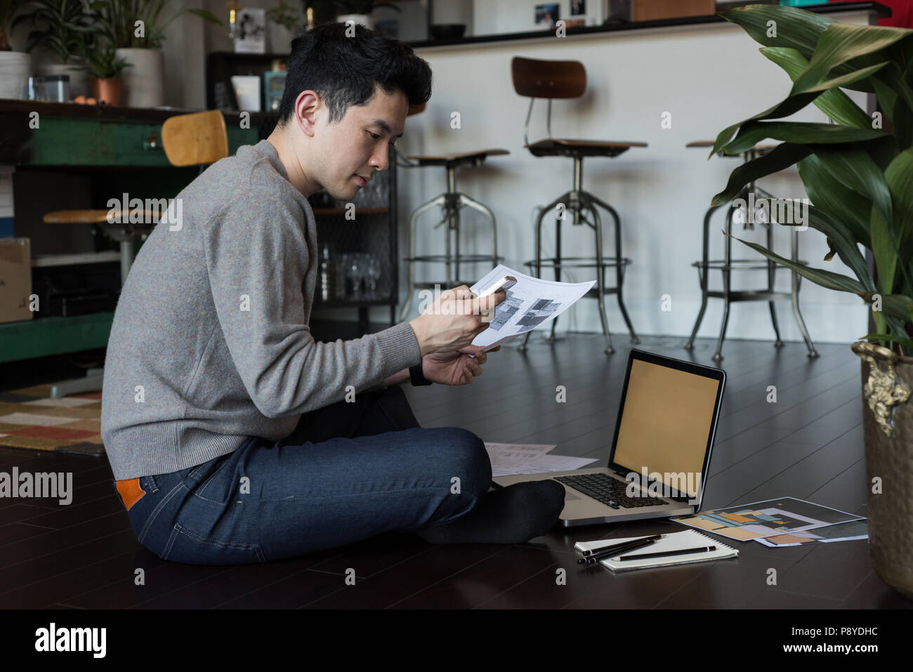 Man working on a project at home - Stock Image