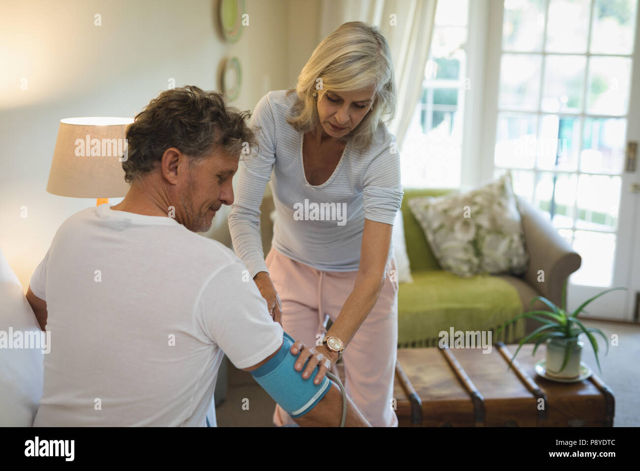 Senior couple checking blood pressure - Stock Image