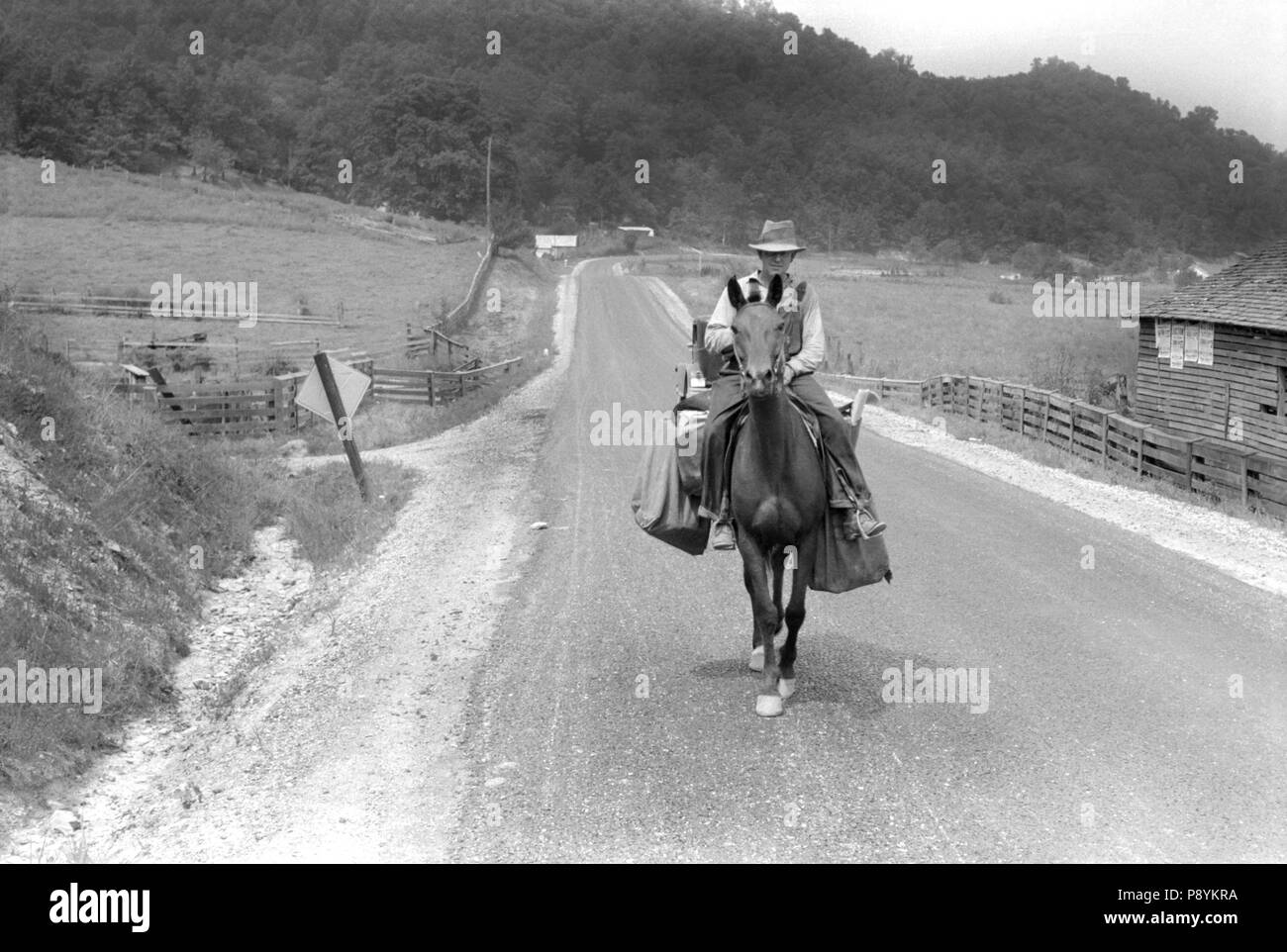 Rural Postman Delivering Mail on Horse, Jackson, Kentucky, USA, Marion Post Wolcott, Farm Security Administration, July 1940 - Stock Image