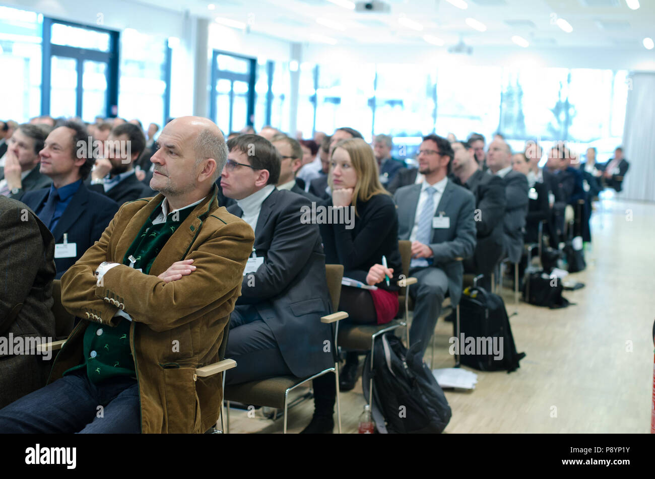Businessmen listening to spokesman during a business congress business conference - Stock Image