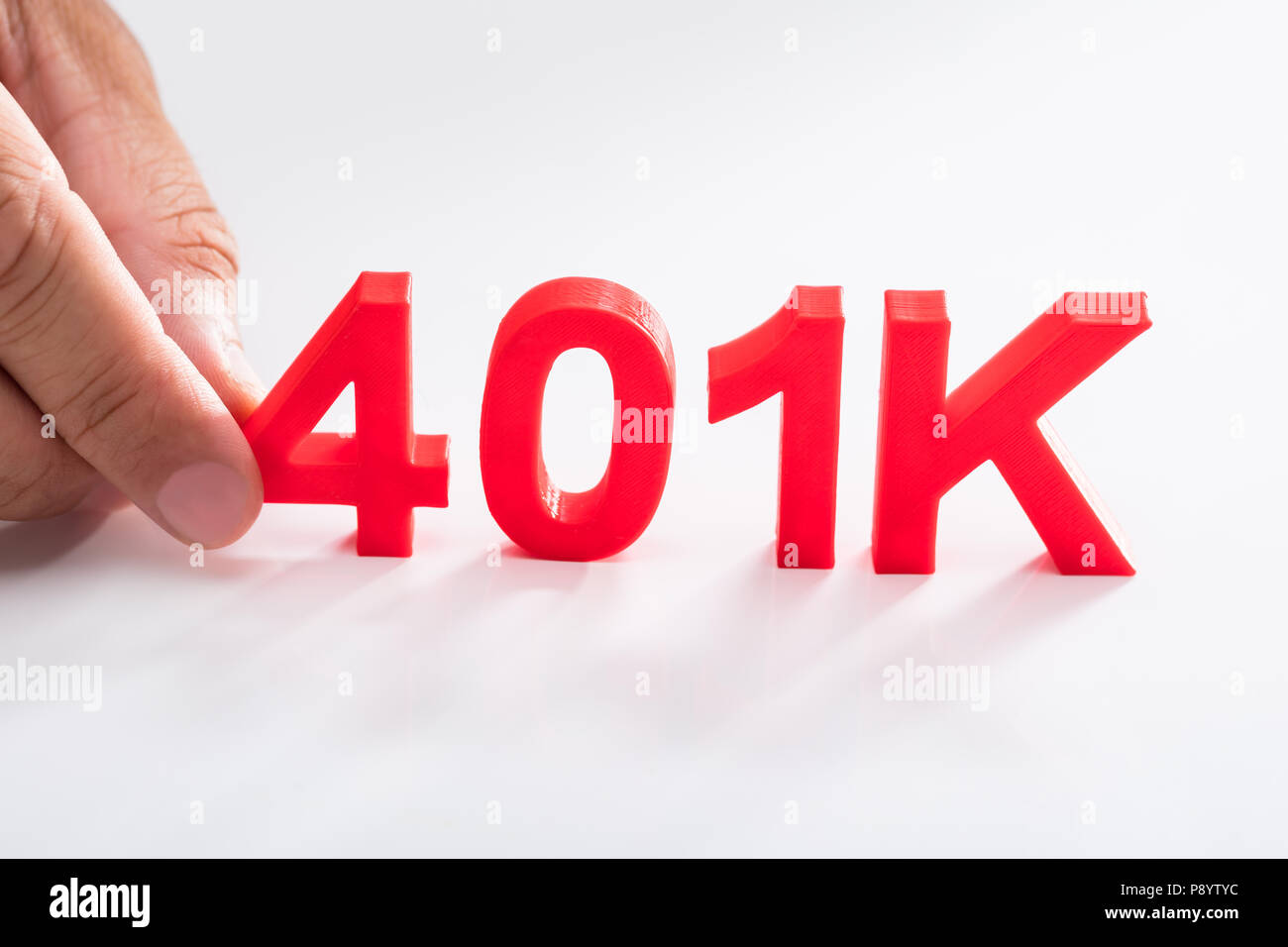 Businessperson holding red 401k pension plan on white background - Stock Image