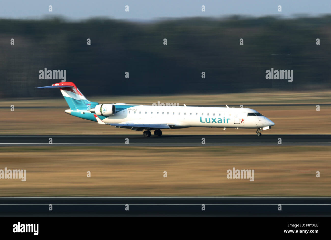 Berlin, Germany, Bombardier CRJ-700ER of the airline Luxair on the runway of the airport Berlin-Tegel - Stock Image