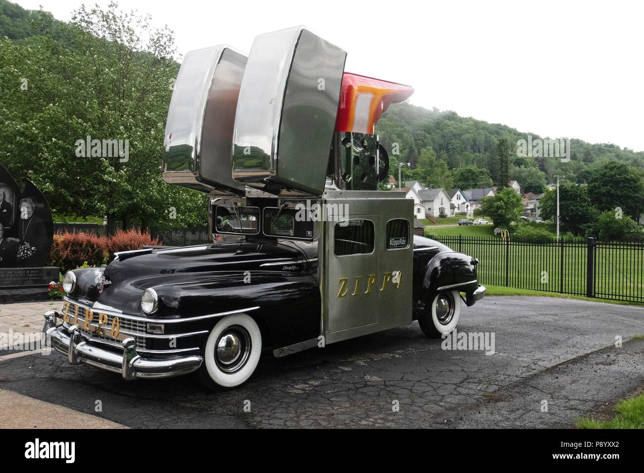 The Zippo car, created from a 1947 Chrysler Saratoga automobile, is photographed in front of zippo Museum in Bradford Pennsylvania. - Stock Image