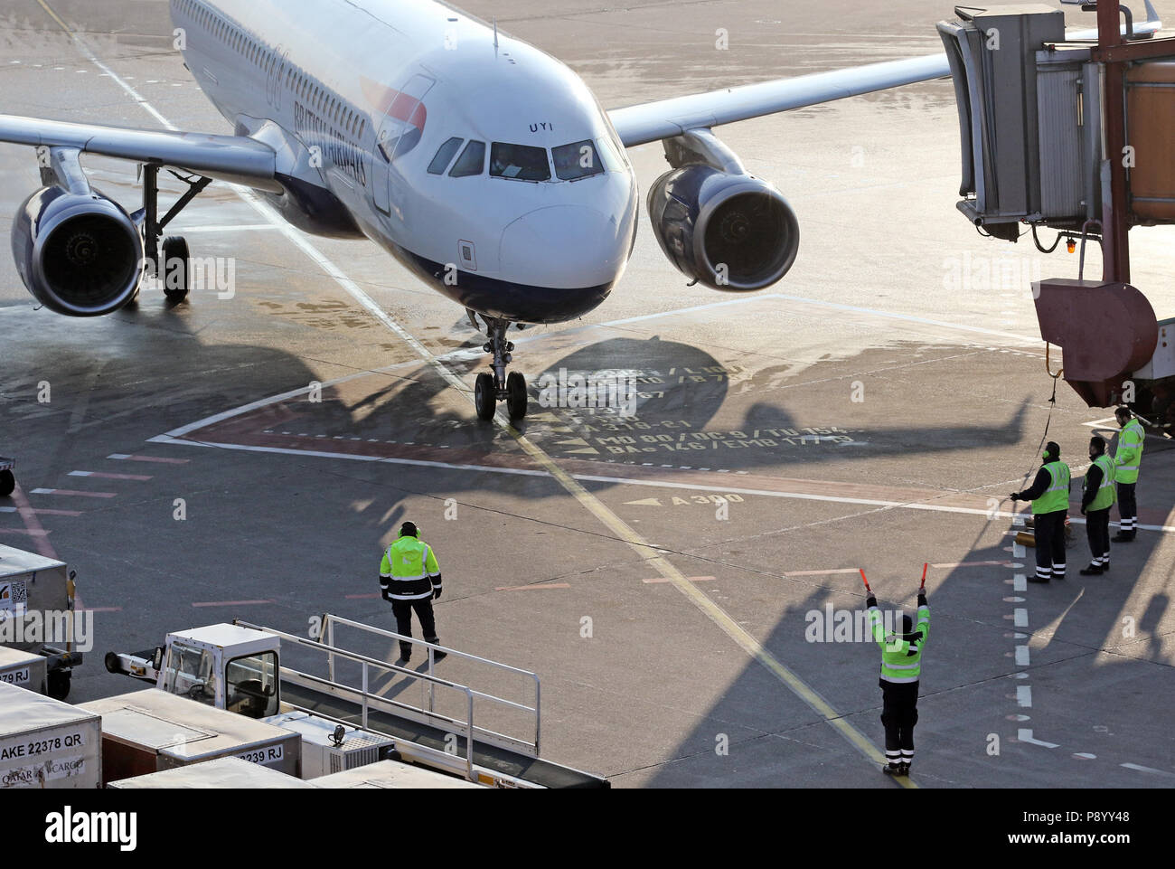 Berlin, Germany, Ramp Agent places a British Airways aircraft on the apron of Berlin Tegel Airport in the parking position - Stock Image