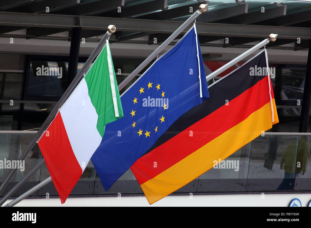 Reischach, Italy, national flag of Italy, flag of the European Union and national flag of the Federal Republic of Germany - Stock Image
