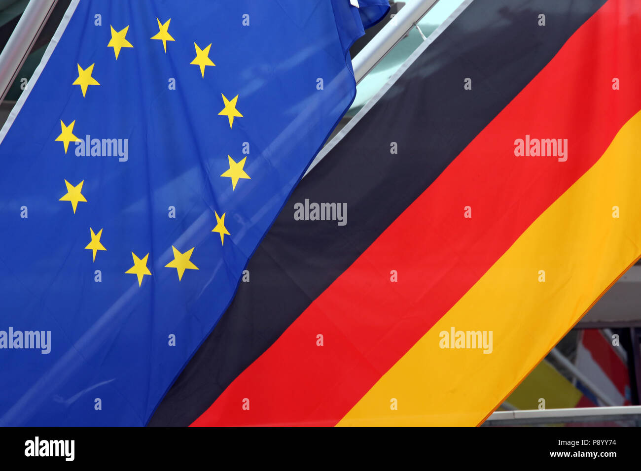Reischach, Italy, flag of the European Union and national flag of the Federal Republic of Germany - Stock Image