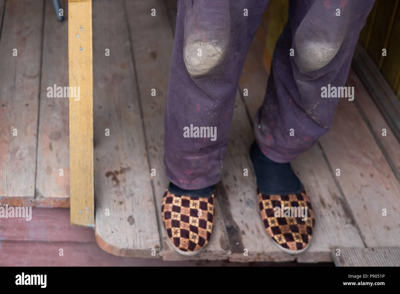 cdf69d375cf3 warm shabby slippers on the background of old wooden floor. - Stock Image