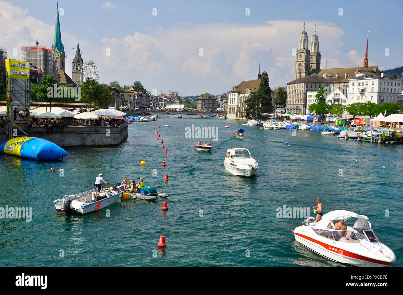 Many boats are on the Limmat-River at Switzerlands biggest party - the Züri-Fäscht. - Stock Image