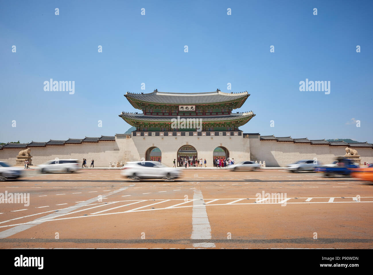 Motion blurred traffic at the entrance to Gyeonghoeru Palace in Seoul, South Korea. Stock Photo