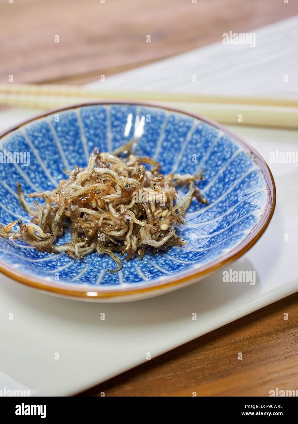 Korean food Stir-fried anchovies - Stock Image