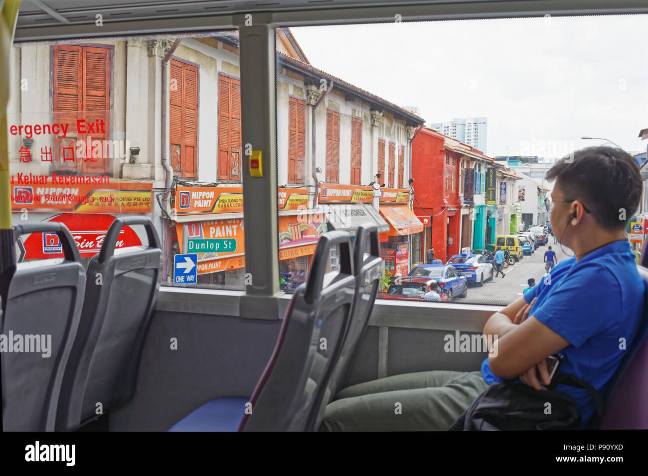 2018 Singapore. Bus ride along Jalan Besar looking at colonial era shophouses which are under conservation. - Stock Image