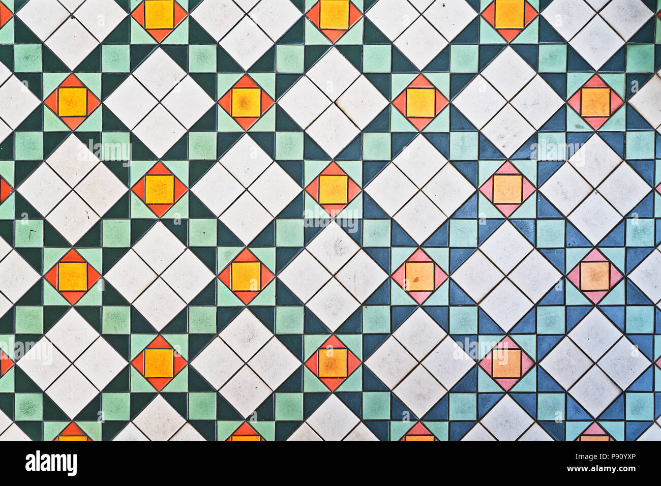 Vintage floor tiles from old houses in Singapore. This type of design dates back to the colonial era. - Stock Image