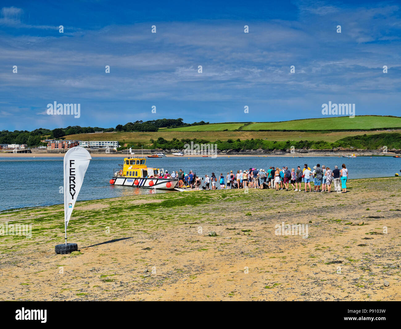 26 June 2018: Rock, Cornwall, UK - Queue of people waiting for the ferry to Padstow. - Stock Image