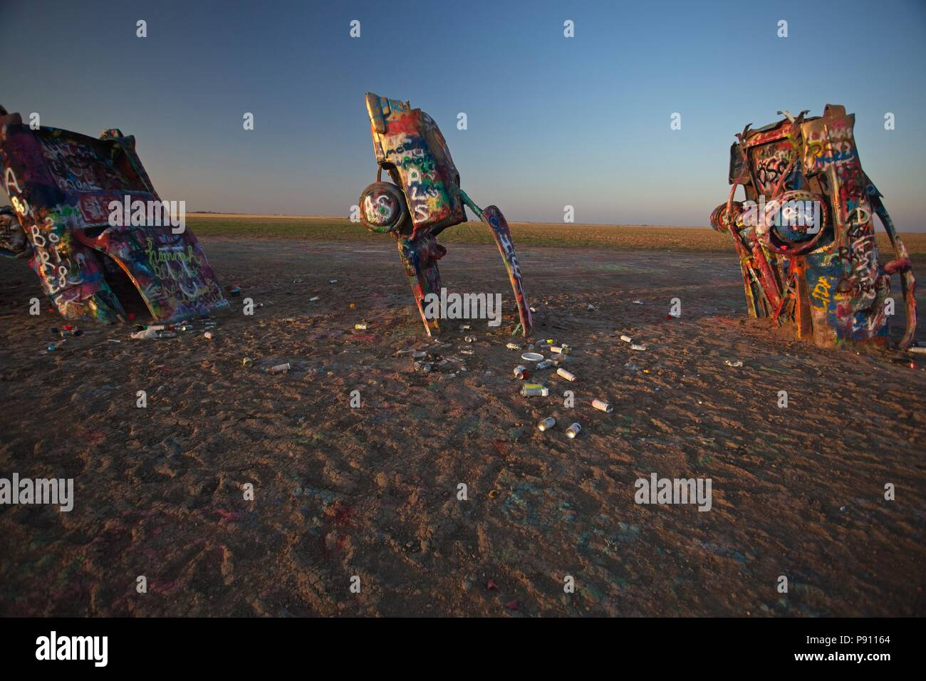 Once unique and iconic Cadillac ranch in Amarillo Texas is now a sad monument to vandalism, grafitti, garbage and distruction - Stock Image